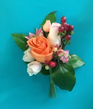 Colorful rose and hypericum boutonniere